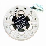 电影在葡萄酒大35mm影片轴的拍板 库存照片