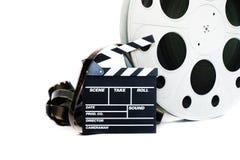 电影拍板和葡萄酒35 mm影片在白色的戏院卷轴 图库摄影