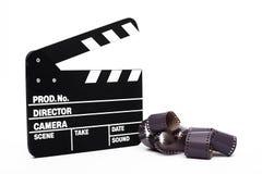电影拍板和35mm影片 免版税库存图片