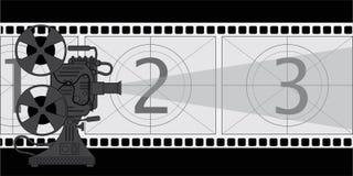 电影放映机,在影片的题材的一张海报 图库摄影