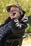 电池人电话前辈谈话 免版税库存照片