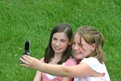 电池女孩电话 免版税库存图片