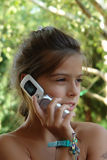 电池女孩电话 库存图片