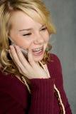 电池少年女孩的电话 库存照片