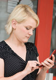 电池拨号电话妇女 免版税库存图片