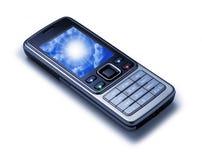 电池查出的移动电话 免版税库存照片