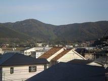 电源杆和家(日本) 免版税图库摄影