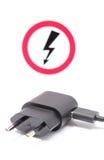 电火花塞和缆绳与高压危险签字 免版税库存照片