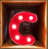 电灯泡发光的信件字母表字符A字体 免版税库存图片