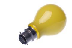 电灯泡查出的淡黄色 免版税库存图片