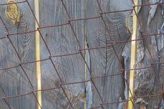 电烙篱芭的滤网有铁锈的并且绘 图库摄影