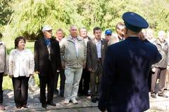 电烫,俄罗斯, 7月04日 2015年:在数字花费的人们在会议上 免版税库存图片