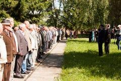 电烫,俄罗斯, 7月04日 2015年:在数字花费的人们在会议上 免版税库存照片