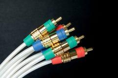 电缆五颜六色的插件 免版税库存照片