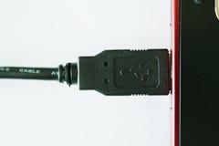 电缆被插入的膝上型计算机usb 库存图片