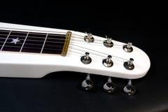 电膝部夏威夷吉他的脖子 免版税库存照片