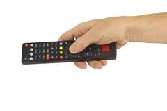 电视遥控在人的手上 免版税库存照片