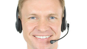 电话中心操作员,微笑的代理接近  免版税库存照片