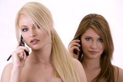 电话二妇女 免版税库存图片