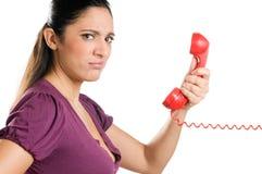 电话使妇女年轻人惊奇 库存照片