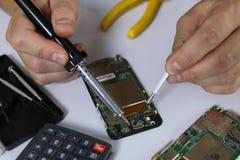 电话修理芯片 图库摄影