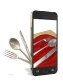 电话和刀叉餐具 库存图片