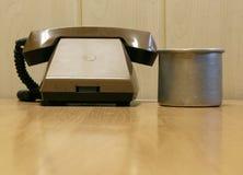 电话和杯子在监狱 免版税图库摄影