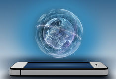 电话和真正围拢的数字式地球 库存图片