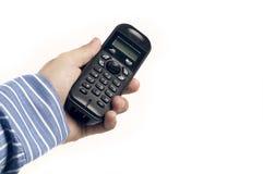 电话在手中 库存照片