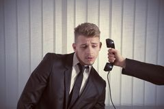 电话惊奇的商人 免版税库存照片