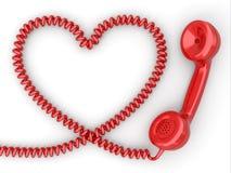 电话接收器和绳子作为心脏。爱热线概念。 免版税库存图片