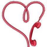 电话接收器和绳子作为心脏。 免版税库存图片