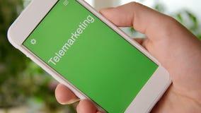 电话推销在智能手机的概念应用 人使用流动app 股票录像