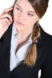 电话的女实业家。 免版税库存图片