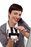 电话的女实业家咨询名片的 免版税库存图片
