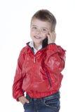 电话的男孩 库存图片