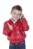 电话的男孩 库存照片