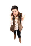 电话的疯狂的恼怒的妇女打手势用手的 库存图片