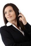电话的美丽的女实业家 免版税图库摄影