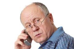 电话的老人 库存照片