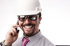 电话的年轻行政工程师 库存图片