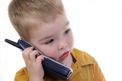 电话联系的小孩 图库摄影
