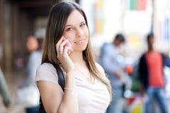 电话联系的妇女 图库摄影