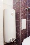 电锅炉墙壁水加热器在卫生间里 免版税库存图片