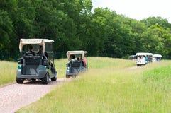 电高尔夫球儿童车 库存照片