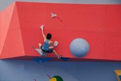 男人和妇女上升的世界杯种族在重庆,中国 库存照片