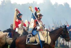 男人和妇女乘驾马 免版税库存图片