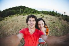 男人和妇女做selfie 库存图片