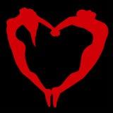 男人和妇女剪影以心脏的形式。 免版税库存照片