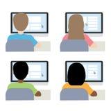 男人和妇女在计算机后面视图前面 库存图片